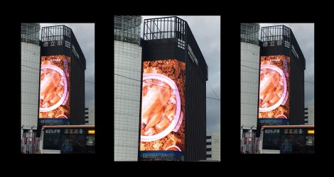 Two different sides of the building apply media facade architecture for advertising